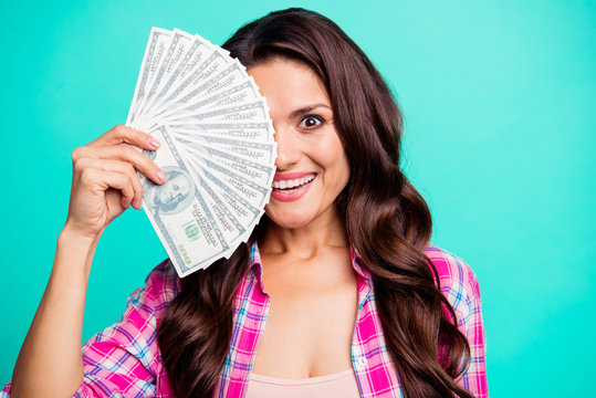 Close up photo beautiful she her lady hands arms hold fan bucks money look glad hiding half face one eye amazed wear casual plaid checkered pink shirt outfit isolated teal bright vivid background