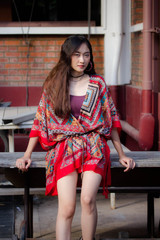 Portrait of thai china adult bohemian girl relax and smile