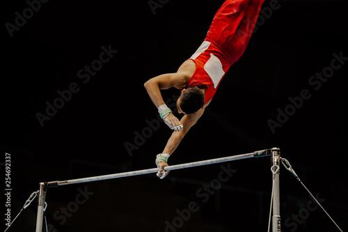 exercise high bar athlete gymnast on black background