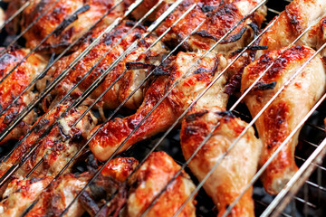 Grilled chicken steak on barbecue grill.
