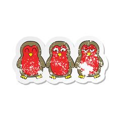 retro distressed sticker of a cartoon christmas robins holding hands