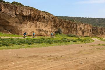Akamas Peninsula - Cyprus, rock wall panorama and road with bikers