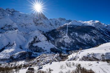 La Grave, Hautes-Alpes, Ecrins National Park, Alps, France: The village of La Grave with La Meije mountain peak in Winter (winter sport ski resort)