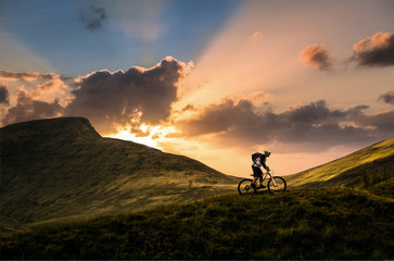 Mountain biker at sunset in the Brecon Beacons, Wales