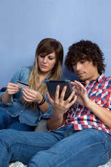 Couple making online purchase with tablet
