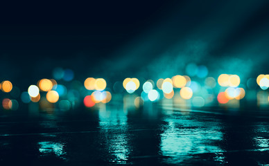 Wall Murals Dark empty stage, multicolored rays of neon searchlight, wet asphalt, smoke, night shooting, bokeh color.