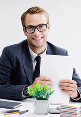 Businessman with documents at office