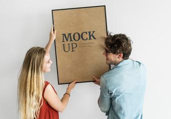 Couple Holding Frame Mockup Together