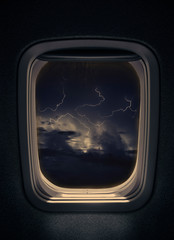 night thunderstorm with lightning  seen from window airplane.