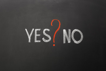 Yes and no with question mark on blackboard