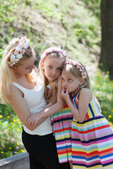 Mother and daughters on beautiful summer day