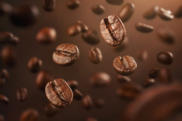 Background made of fresh coffee beans falling down with copy space