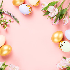 Festive Happy Easter background with decorated eggs, flowers, candy and ribbons in pastel colors on...