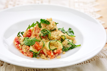An easy, zesty summer salad with a Mediterranean flair featuring Israeli couscous and chopped summer vegetables