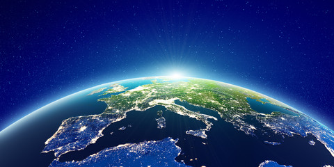 Wall Mural - Europe sunrise from space