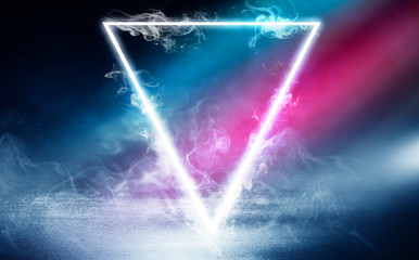 Neon triangle shape in smoke on a dark background. Background of empty room with concrete floor, neon light Fotomurales