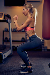 Young Caucasian woman doing endurance in gym. Healthy lifestyle concept.