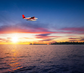 Beautiful sunset on Maldives resort with seaplane