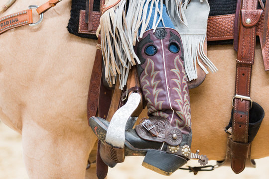 Cowboy boot of rider in saddle