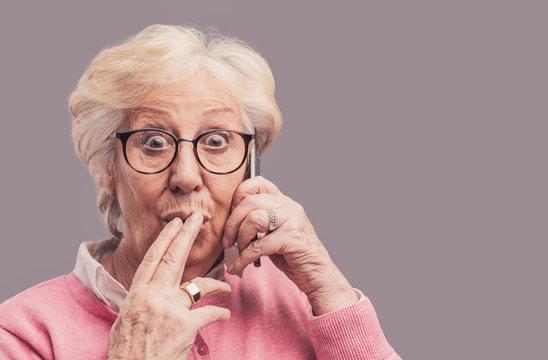 Senior lady gossiping on the phone