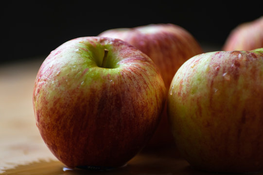 Close-up of wet apples on table during autumn