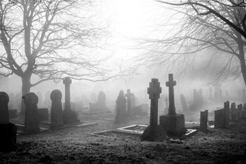 scarey grave yard in the mist back and white photograph
