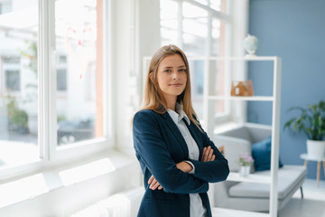 Portrait of a confident young businesswoman, standing in office