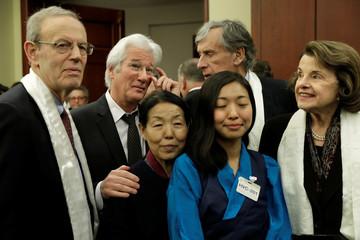Senator Dianne Feinstein smiles as Actor Richard Gere poses for a group photo with Dawa Chokyi
