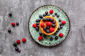 Pancakes with blueberries, raspberries and black currants