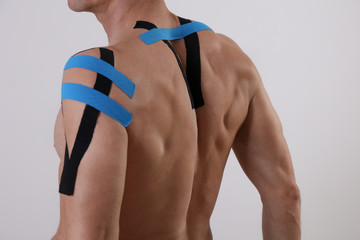 Kinesiology taping. Back pain, Sport man exercising injury. Alternative medicine concept