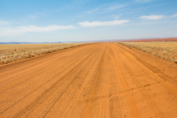 Drive through the desert of Namibia, red sand