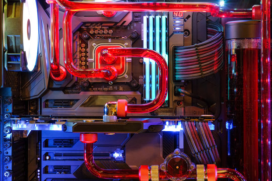 Close-up and inside Desktop PC Gaming and Water Cooling CPU with LED RGB light show status on working mode, interior PC case technology background