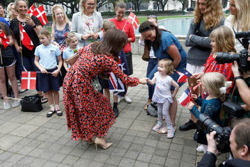 Danish Crown Princess Mary is greeted by a child outside City Hall in Houston