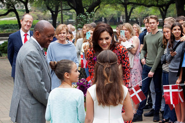 Danish Crown Princess Mary interacts with Paulina Buendia Andersen as Houston Mayor Sylvester Turner smiles outside the City Hall in Houston