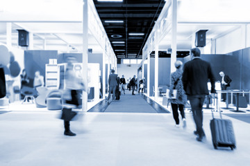 blurred people at a trade fair