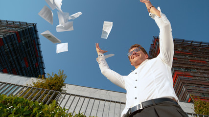 CLOSE UP: Excited businessman celebrates finishing his important work project.