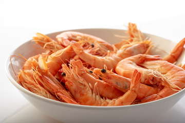 a plate with boiled shrimps