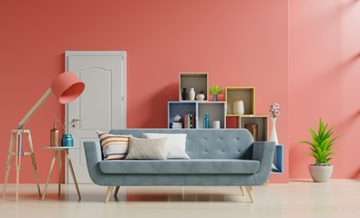 Empty living room with with sofa and green plants,lamp,table,shelves on coral color wall background,3d rendering Wall mural