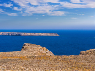 Blue sea and rocky island seen from Gramvousa fort in Crete, Greece