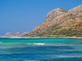 Perfect blue water and rocky hills of Crete - Greece