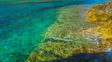 Crystal clear turquoise water and rocky seaside