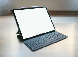 new pro tablet on the table with pencil and keyboard cover blank screen Fotobehang