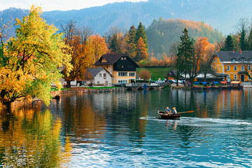 Beautiful landscape of Bled Lake and people in boat Slovenia