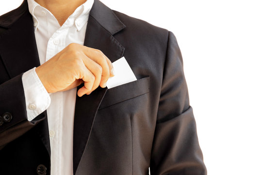 Businessman taking out business card from his suit pocket isolated clpping path.