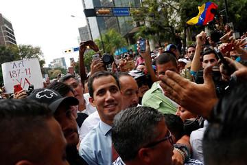 Venezuelan opposition leader Juan Guaido walks amid the crowd during a protest against Venezuelan President Nicolas Maduro's government in Caracas
