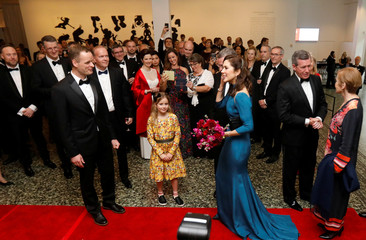 Danish Crown Princess Mary receives flowers from a supporter as she arrives at a gala at the Museum of Fine Arts, Houston in Houston, Texas