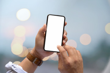 Male hand and blank screen mobile phone