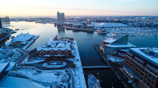 An aerial view of Baltimore, Maryland on a cold, snow covered morning in December.