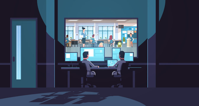 two men looking at monitors sitting behind glass window teacher with pupils studying in school classroom dark office interior surveillance security system flat horizontal