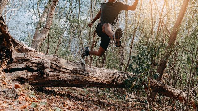 Image of Athlete trail running, runner running on hill.